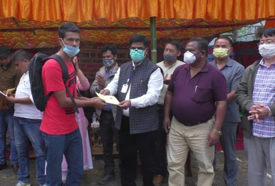 Minister Sharmahands over allotment orders to beneficiaries